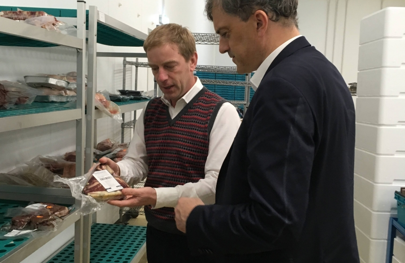 Julian Smith being shown Farmison's famous meat